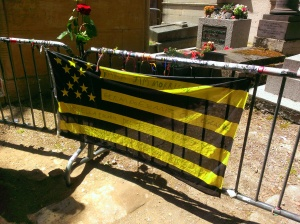 The flag that adorned the gate that protected the grave of Jim Morrison.
